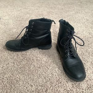 Black leather ankle boots with zipper
